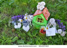 two small houses berry flowers text stock photo 694557475
