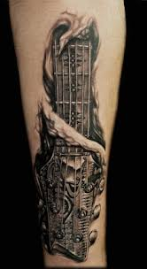 charcoal black guitar and microphone tattoo male forearms musik