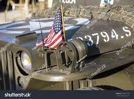 wwii jeep in action closeup american military jeep american flag stock photo 358915136