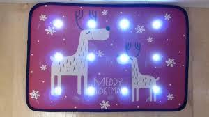 reindeer musical door mat with led lights 60 x 40cm