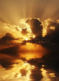 dramatic sundown scene with dark clouds and rays over sea good as