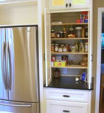 next kitchen furniture pantry next to counter depth fridge zessn kitchens pantries