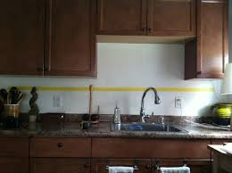 the drama of the kitchen backsplash when i was told the guys would be coming to do the tiles i had said that i wanted them staggered like bricks to the head maintenance guy