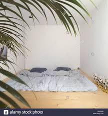 minimalist bed on floor bedroom wood flooring minimalist interior