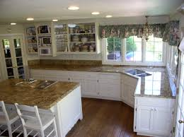 Granite For White Kitchen Cabinets by Plain White Kitchen Cabinets With Brown Granite Countertops Off