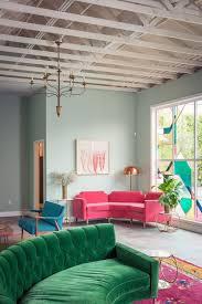Large Pink Area Rug Living Room Green Sofa Chandelier Nice Wood Ceiling Nice Pink