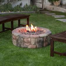 outdoor propane fire pit backyard patio deck stone fireplace