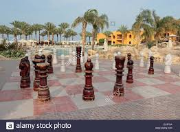 large wooden chess set by hotel swimming pool at the stalla makadi
