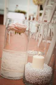 lace and pearls themed wedding centerpieces and decorations