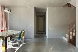 interior modern house dining room concrete wall stock photo