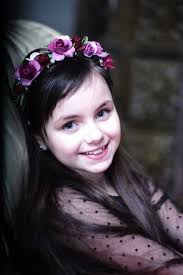 Portrai Of Cute Small Blueeyed Brunette Smiling Girl With Wreath