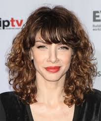 romina gaetani medium curly casual hairstyle medium brunette