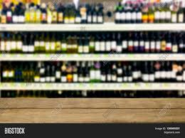 Liquor Display Shelves by Wine Liquor Bottle On Shelf Blurred Background With Empty Wooden