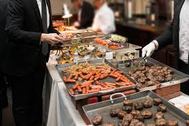 people taking food in buffet catering dining eating party event