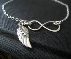 silver infinity bracelet with charms images Infinity bracelet with angel wing charm sterling silver dainty jpg