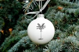 big porcelain bauble with palm tree by kina ceramics