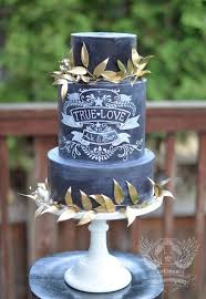black chalkboard wedding cake with gold leaves deer pearl flowers