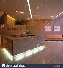 Granite Reception Desk Under Lit Granite Desk In Reception Area Of City Office Stock