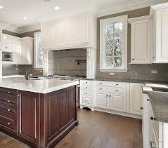 classic white kitchen with stained island large wood hood with