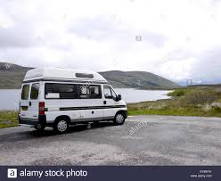 pezo auto peugeot auto sleeper campervan parked beside loch glascarnoch
