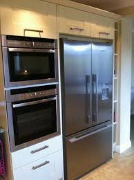 next kitchen furniture integrated oven microwave tower next to american fridge freezer