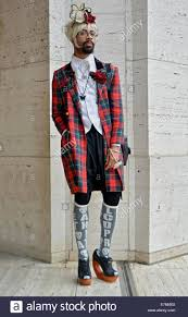 portrait of a gender ambiguous man in a skirt at fashion week 2014