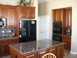 kitchens with white cabinets and black appliances oak kitchen black appliances black stainless steel kitchen