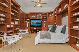 queen anne high school penthouse has a library for a bedroom it s not the first time a queen anne high school condo made a beeline for our bookish hearts a loft listed in late september came with a tiny sliding ladder