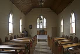 church chapel with wood walls painted white and wood ceiling