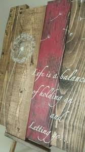 dandelion wood plaques wall reclaimed wood wall is a balance of holding on