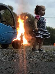 Fire Girl Meme - photo of girl standing stoically by fire is the latest and