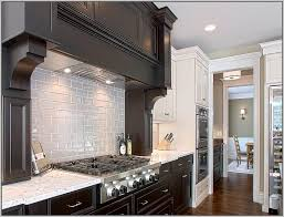 Gray Subway Tile Backsplash With Dark Cabinets Boasts White Shaker - Grey subway tile backsplash