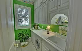 atlanta green foo dogs laundry room rustic with wallpaper border
