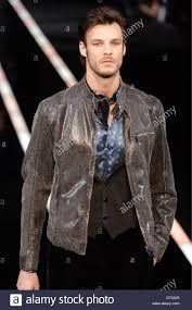 motorcycle over jacket emporio armani menswear milan a w brunette male wearing a grey