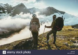 travelers stock images Couple travelers on mountain summit together love and travel stock jpg