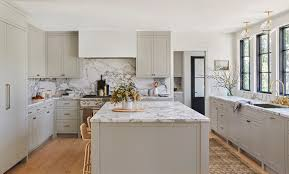 white kitchen cabinets with marble counters 11 gorgeous marble backsplashes that ll refresh any kitchen