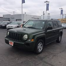 gold jeep patriot inventory located at 2245 s kingshighway st louis mo 63110