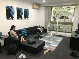 lounge area with balcony picture of liv apartments sydney