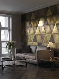 Formatos Cerámicos Inusuales Escalados Y Tonos Dorados CTO Home - Living room wall tiles design
