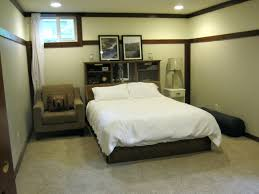 basement bedroom ideas with grey stripped bedding and dark green
