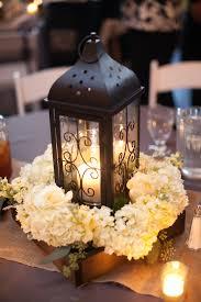 lantern centerpieces black lantern and white hydrangea centerpiece wedding decor