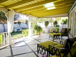 exterior grren wooden patio with white curtain also green