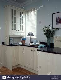 modern kitchen worktops small music centre below fitted cupboard in modern kitchen with