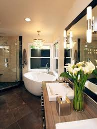 26 ultra modern luxury bathroom designs style estate a neutral color palette brings warmth to this transitional bathroom an elegant chandelier complements the