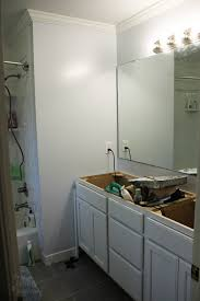 how to hang a frameless oval mirror pretty handy