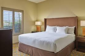 resort suites in tucson az el conquistador golf resort large bed with a nightstand and lamp on each side