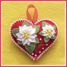diy felt and beaded ornament with poinsettias ornaments