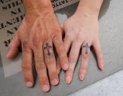 49 cross tattoos on finger