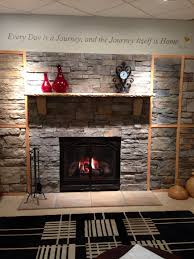 living room with stone wall fireplace electric carameloffers