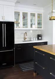 black french door refrigerator ivory quartz and butcher block